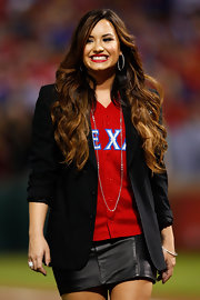 Demi Lovato added a touch of elegance with a long silver chain necklace.