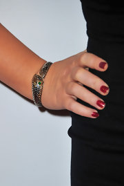Amy Poehler added a subtle touch to her look with a silver snake bracelet. A green gemstone accented her jewels.