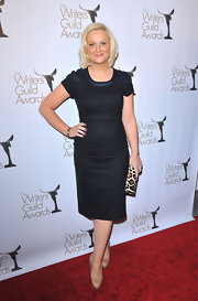 Amy Poehler added visual interest to her 2011 Writers Guild Awards look with a leopard print clutch.