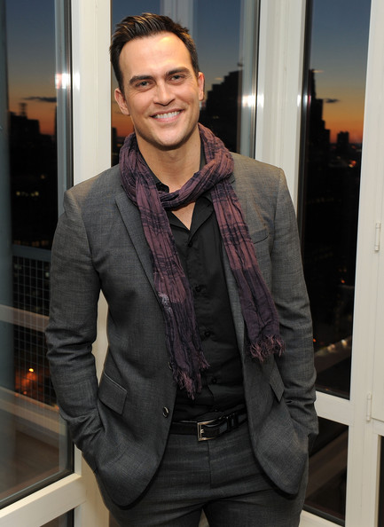 A purple patterned scarf added some color and fun to Cheyenne Jackson's outfit.