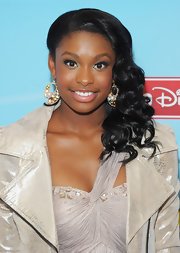 Coco Jones kept the attention to her luminous face by choosing a pair of statement earrings.