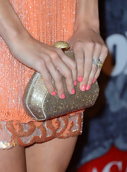 "Carrie Underwood sparkled at the 2012 American Country Awards, accessorizing with Daniel Swarovski's gold crystal ""Revival"" clutch."