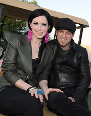 Shawna Thompson's hot pink dangling earrings added a splash of color to her dark outfit at the 2012 Arizona Country Thunder Music Festival.