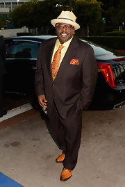 Cedric the Entertainer's brown suit looked subdued, but the pop of color from his tie and hanky livened it up.