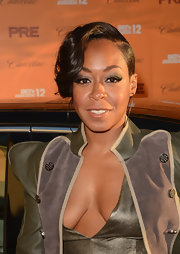 Tichina Arnold wore her hair in an updo with side-swept wavy bangs at the 2012 BET Awards.