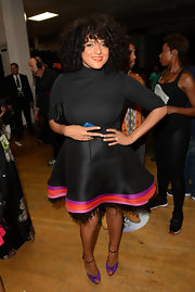 A colorful billowy skirt added lots of flair to Marsha Ambrosius' black turtleneck.