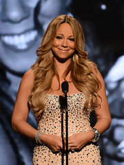 Mariah Carey took to the stage at the BET Awards in a silver studded gown and beachy blond waves.