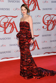 Devon arrived at the CFDA Fashion Awards wearing a glamorous rose-print gown with a cute peplum detail.