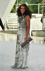 June Ambrose arrived at the 2012 CFDA Fashion Awards in her silver gown with which she styled wore a matching sequined purse.