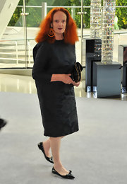 Grace Coddington made a statement in orange geometric circle earrings at the 2012 CFDA fashion awards.