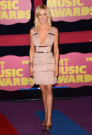 Normally one to err on the side of glamour, Kellie Pickler mixed things up at the CMT Awards in this super-sexy fringed dress. The tight mini showed off her assets quite spectacularly.