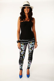 Karen Fairchild paired floral leggings with a corset top for a casual, sexy look.