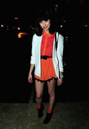 Kimbra debuted an adorably chic look at Coachella in a bright orange skirt with black lace detail.