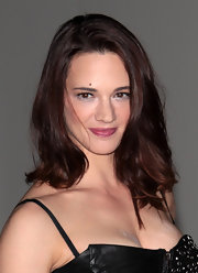 Asia Argento kept her look as natural as can be as she let her waves down at the Convivio gala.