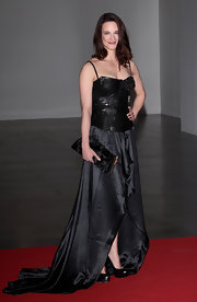 Asia Argento attended the 2012 Convivio charity gala wearing a black leather and satin gown.