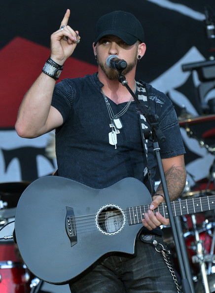 For an edgy look, Brantley Gilbert accessorized with a layered cross-pendant and dog tag necklaces.