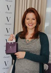 Sarah Drew flashed a smile at the DPA Golden Globe Awards Gift Suite in a medium layered haircut.