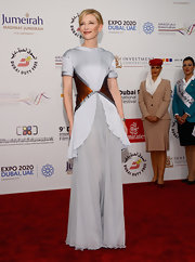 Cate was a vision in this silky gray evening dress with burnt orange waist accents.
