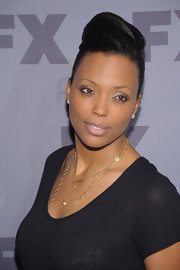 Aisha Tyler attended the 2012 FX Ad Sales Upfront event wearing her hair in a sleek updo.