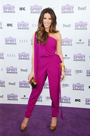Kate Beckinsale paired her daring jumpsuit with peep-toe pumps.