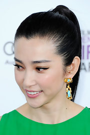 Li Bingbing wore her hair in a sleek wrapped ponytail at the 2012 Independent Spirit Awards.