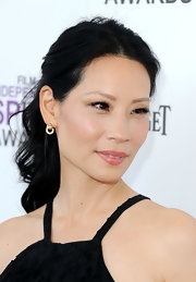 Lucy Liu attended the 2012 Independent Spirit Awards wearing her hair in a pretty curled ponytail.