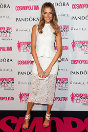 Laura Dundovic's white lace peplum dress at the 2012 Fun Fearless Female Awards gave her a very girly aura.