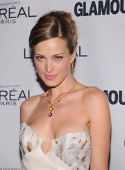 Petra gave a smoldering stare with her hair side-swept and styled in a curled updo.