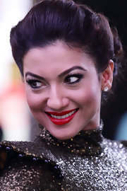 Gauhar Khan styled her hair in a loose updo for an ultra-glam finish.