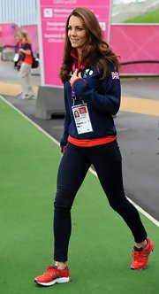 Kate Middleton was totally team GB, pairing a blue and red zip-up with bold red Adidas sneaks.