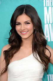 Victoria Justice's long spiral waves are a must-replicate summer style.