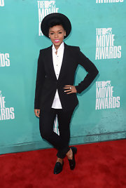At this year's MTV Movie Awards she cuffed the ankles of her classic black suit to show off her patent wingtip penny loafers.
