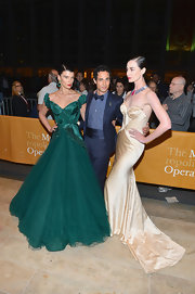 Erin O'Connor attended 'L'Elisir D'Amore' wearing a fitted champagne floor-length strapless dress that featured a gathered bodice.