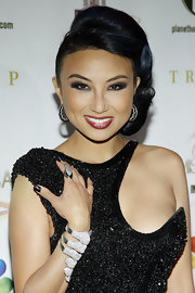 Jeannie Mai sported subtle curls arranged in a retro-glam side-swept updo when she attended the 2012 Miss USA pageant.