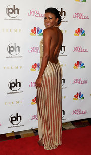 Leila looked striking in this backless gold striped gown at the Miss Universe Pageant.