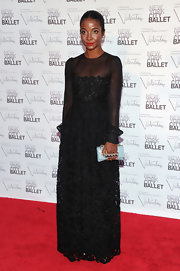 Genevieve Jones carried a baby blue patent leather clutch with a gold studded handle at the 2012 New York City Ballet Fall Gala.