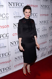 Rachel Weisz looked sleek and modern in a satin little black dress with red embroidery.