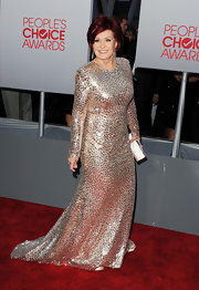 Sharon Osbourne stood out on the red carpet in a mirrored evening dress with long sleeves for the People's Choice Awards.