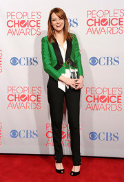 Emma Stone shied away from typical red carpet fodder at the People's Choice Awards in this stunning emerald and black tux-style suit.