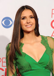 Nina Dobrev wore her long hair super sleek and straight with a center part at the 2012 People's Choice Awards.