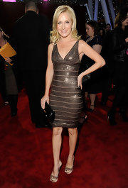 Angela Kinsey looked ready for a night out at the People's Choice Awards in a bronze bandage dress.