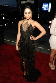 Vanessa Hudgens accented her exotic spider web-style gown with a tough-glam Fizzy Studded clutch.
