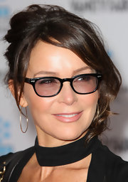 Jennifer Grey complemented her messy updo with a pair of gold hoops when she attended the 'Cabaret' premiere.