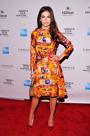 Camilla Belle's brightly printed dress called for an equally vibrant shoe. And she added just the right amount of vivid color with cherry red satin pumps.