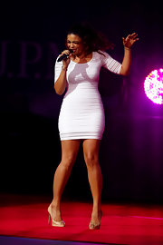 Jordin let her body shine, styling a slim-fitting white bodycon with subtle nude peep toes.