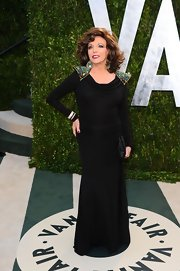 Joan Collins exuded old Hollywood glamour at the Vanity Fair Oscar Party with a flattering black evening dress with beaded shoulder accents.