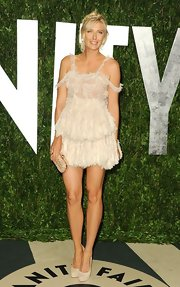 Anna Sharapova showed off her tan legs in a lacy cocktail dress that could have passed for a fancy negligee.