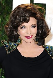 Joan Collins wore a dazzling pair of dangling gemstone earrings to the Vanity Fair Oscar Party.