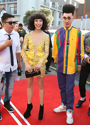 Clunky, avant-guarde ankle boots sassed up Kimbra's sweet style.