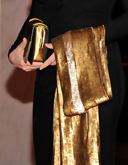 Diane Sawyer finished off her black-and-gold-themed ensemble with a glamorous sequined scarf at the 2012 White House Correspondents' Association Dinner.